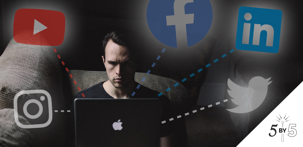 man on laptop with social logos