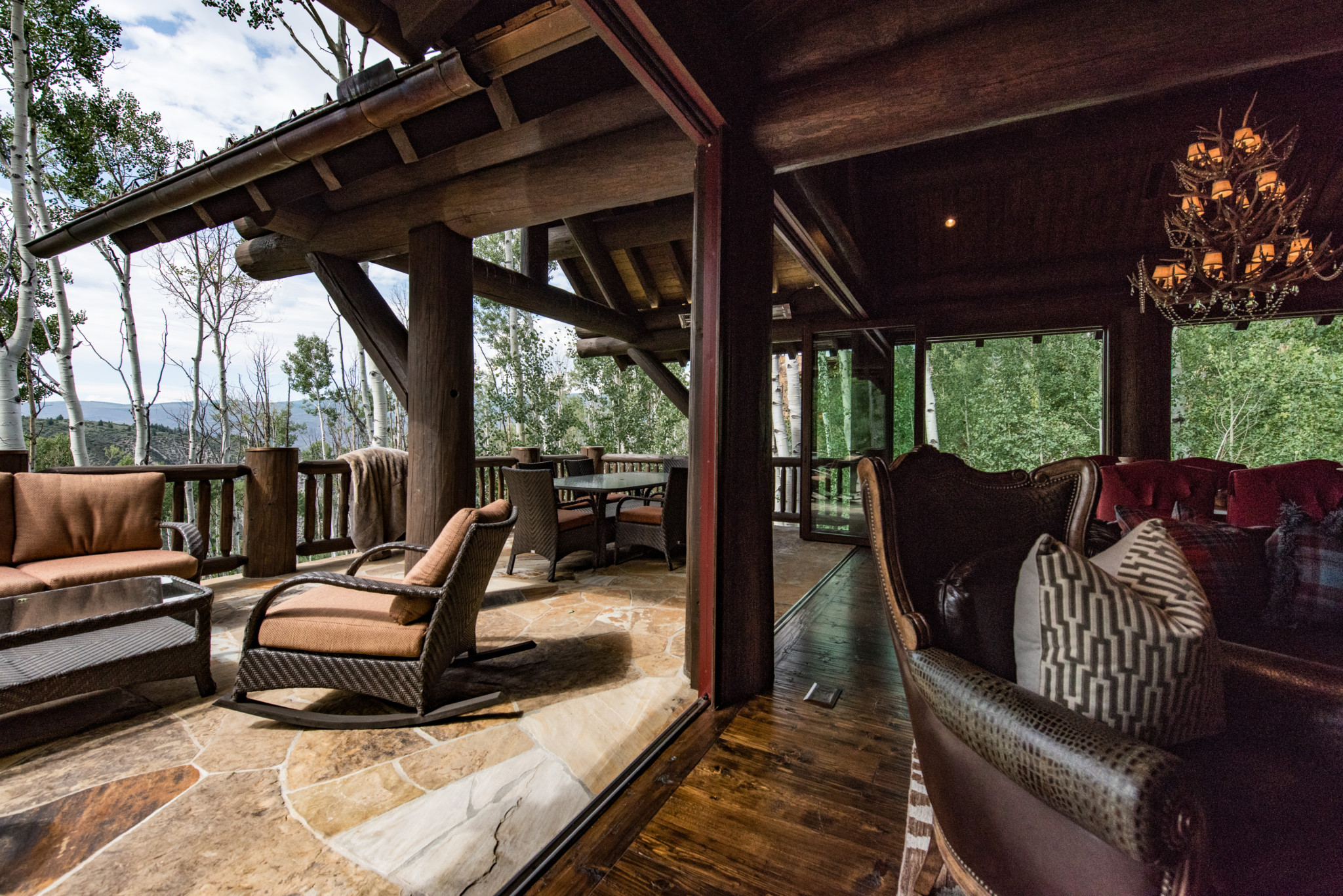 Arrowhead-custom-log-home-interior-exterior-sun-room