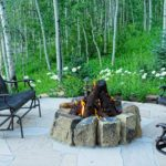 Vail-Mountain-Elegant-stone-and-steelog-firepit-on-flagstone-patio