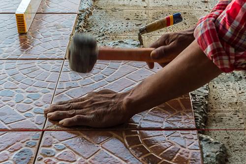 Man replacing floor
