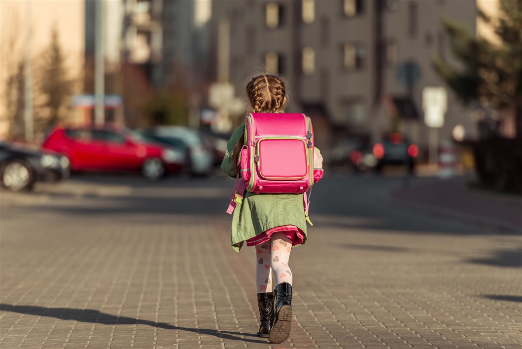 Girl walking on her way to learn spanish