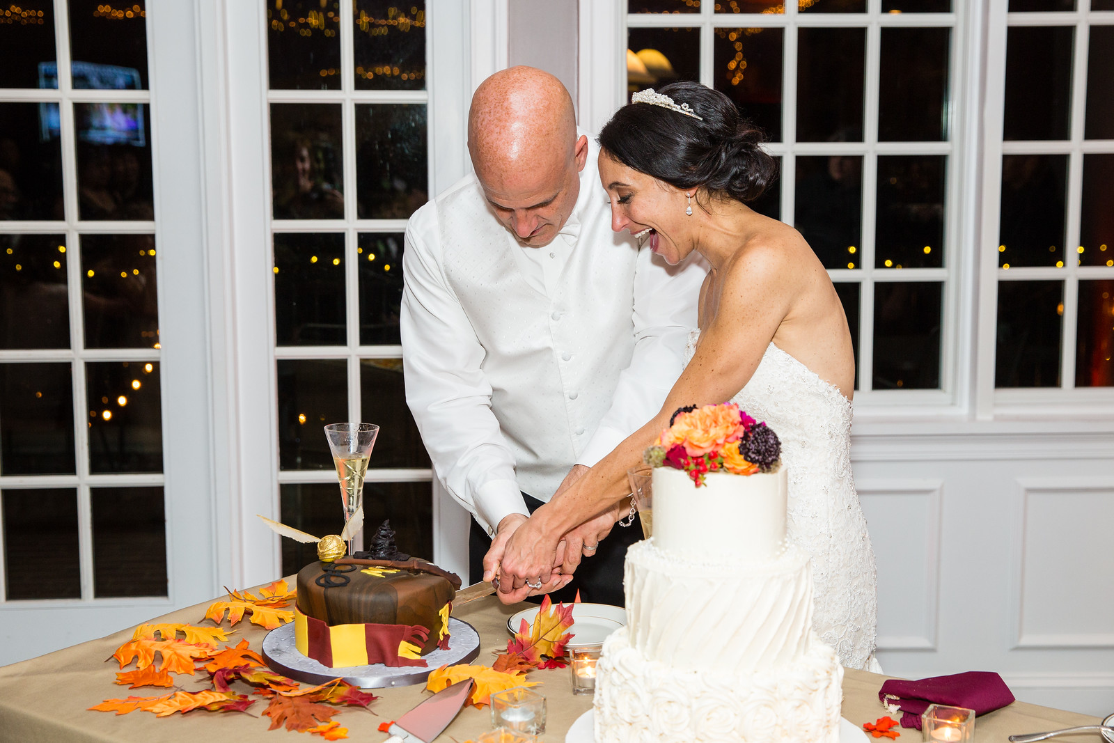 bride and groom cutting wedding cake fall weddings by perfect planning events