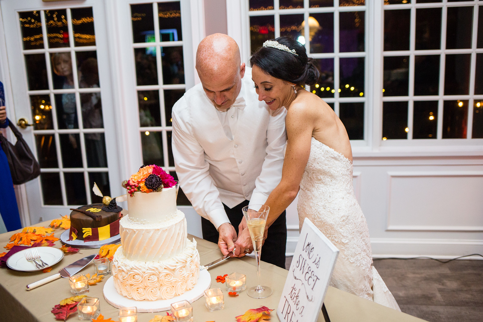 cutting of wedding cake by perfect planning events