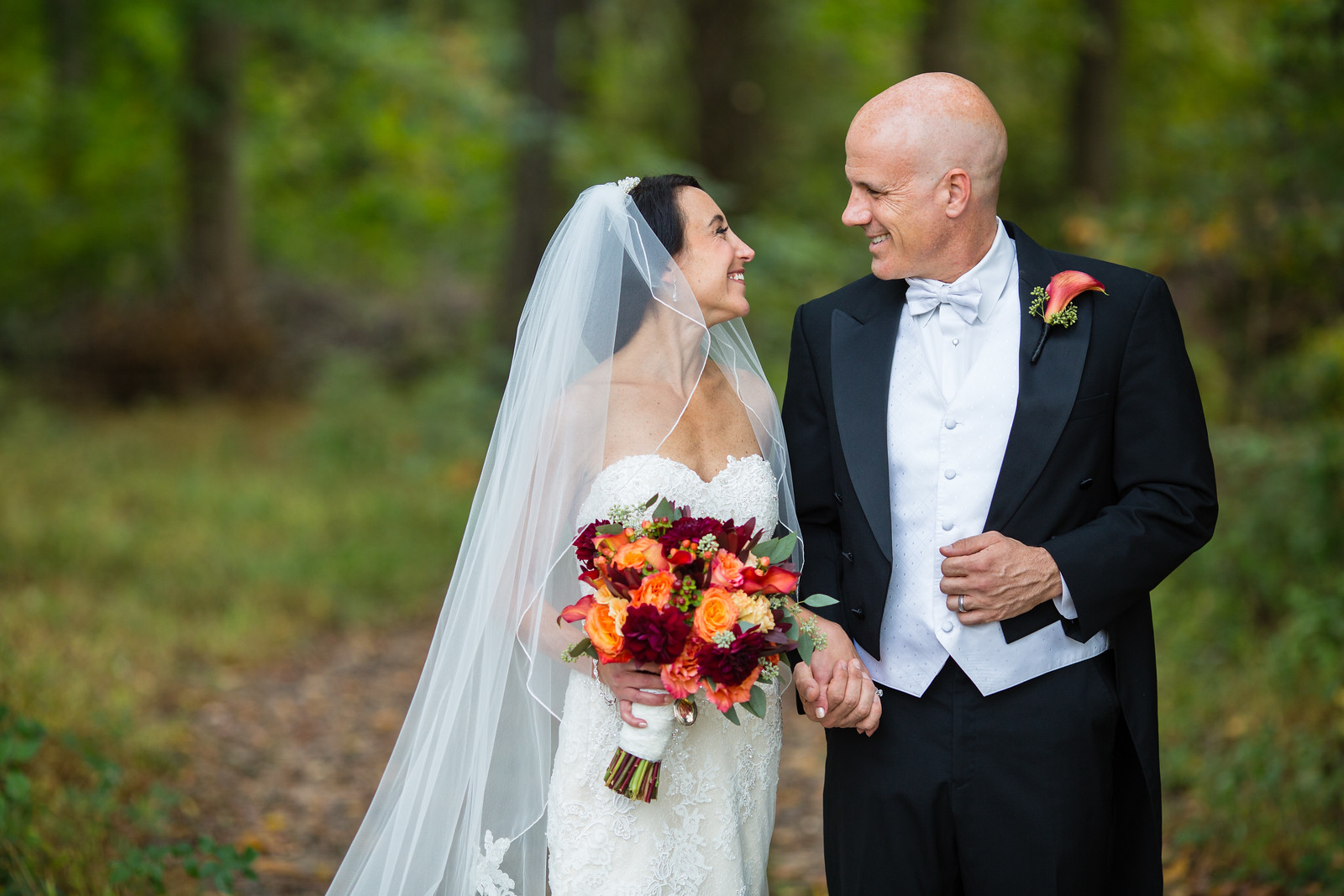 bride and groom outdoor fall wedding ceremony by perfect planning events
