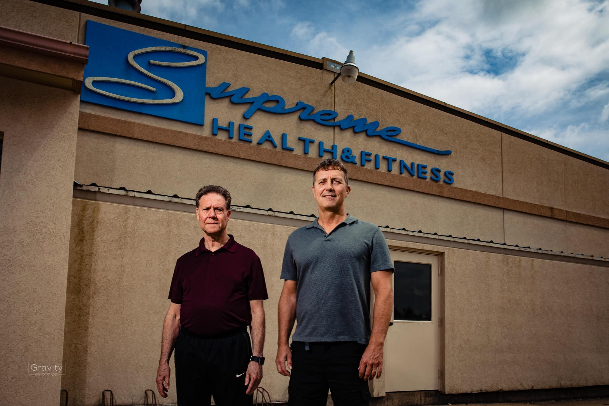 Joe Wirkus and Howie Grigg in front of their club, Supreme Health and Fitness