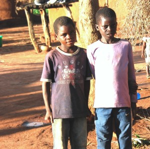Two young boys who are best friends in the village.