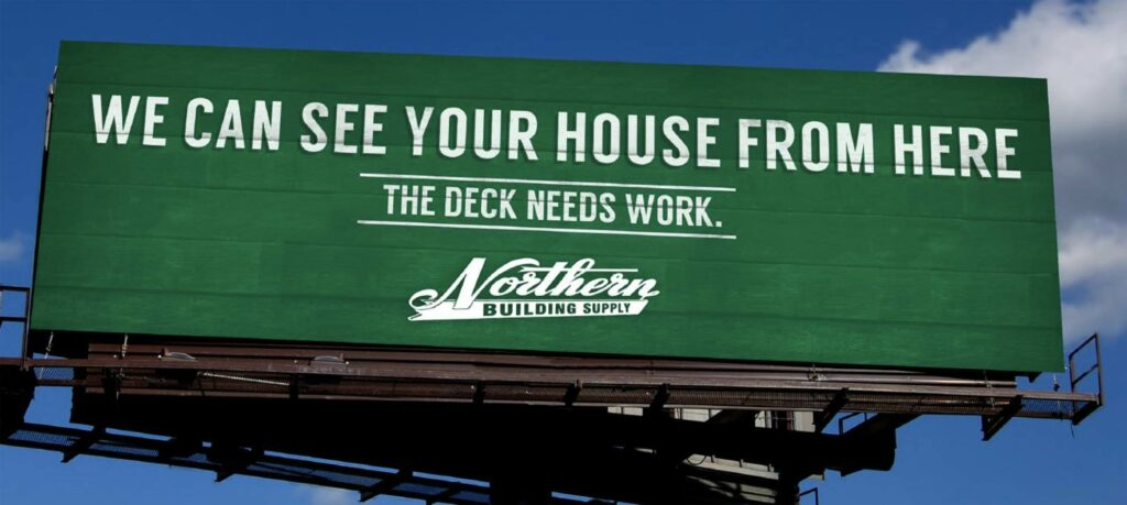 "Green billboard with text ""We can see your house from here."""