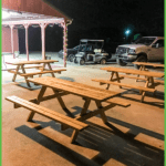 Picnic Tables on the Patio Under the Lights