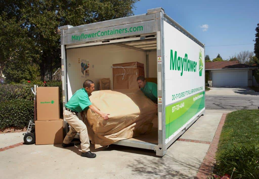 mayflower portable container being loaded by professional movers