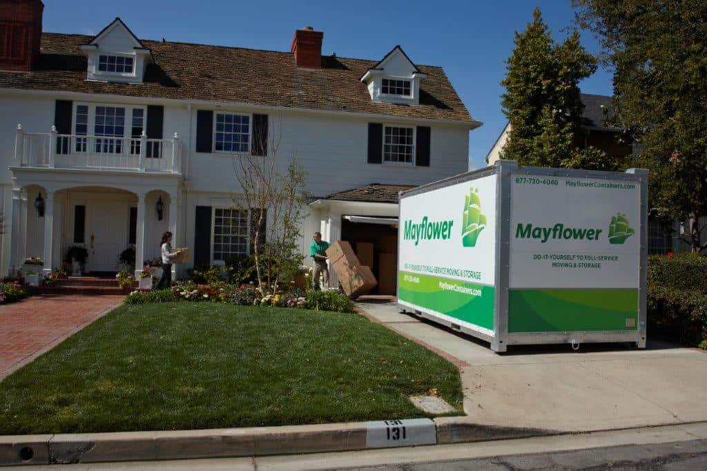 mayflower portable storage containers in driveway of a house