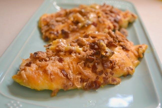 Smothered and Covered Chicken Breasts -- A quick dinner. Chicken breasts smothered and covered in honey mustard, cheese, bacon and french fried onions.