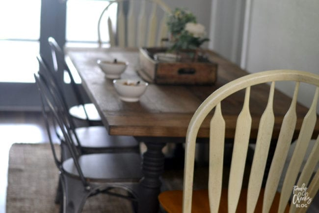 Farmhouse dining room - DIY farmhouse table paired with industrial metal chairs and a bench.