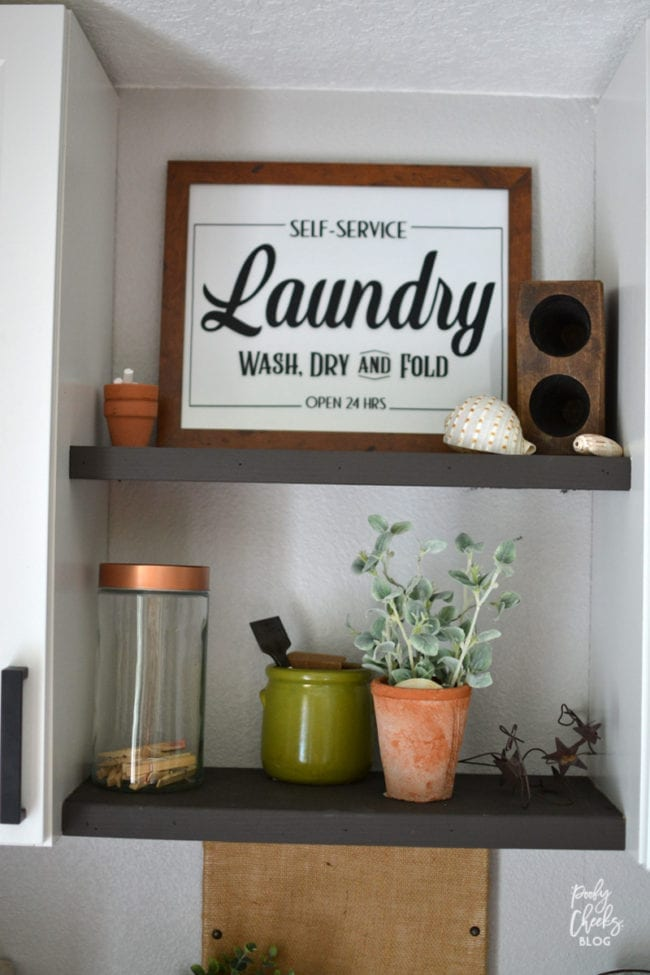 Laundry room before and after - an ugly boring laundry room transformed into a farmhouse laundry room.