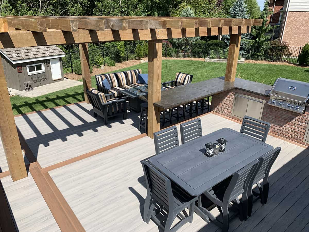 Back patio with two dining tables and a bbq.