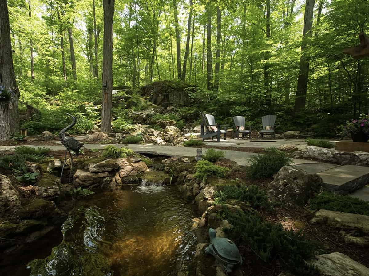 Forest escape with a firepit and pond.
