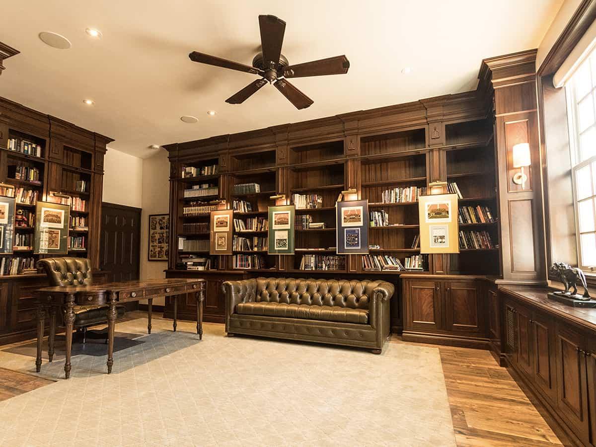 Wooden bookshelves built into wall.