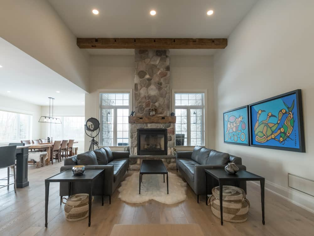 Rustic living room with stoned chimney.