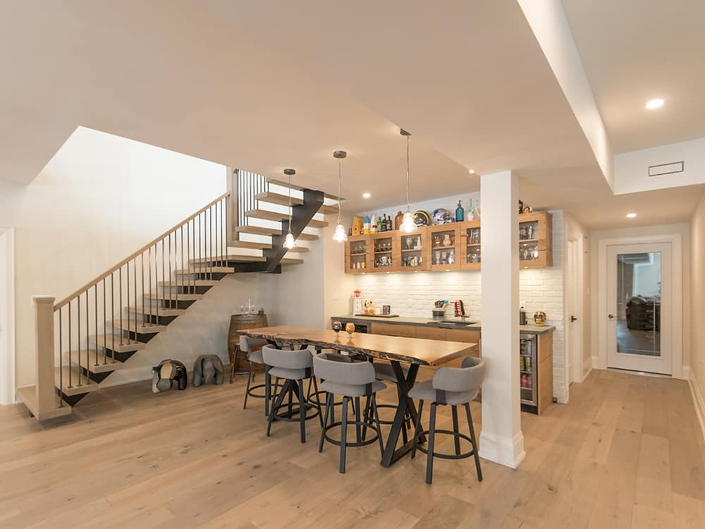 Basement bar area with dark staircase.