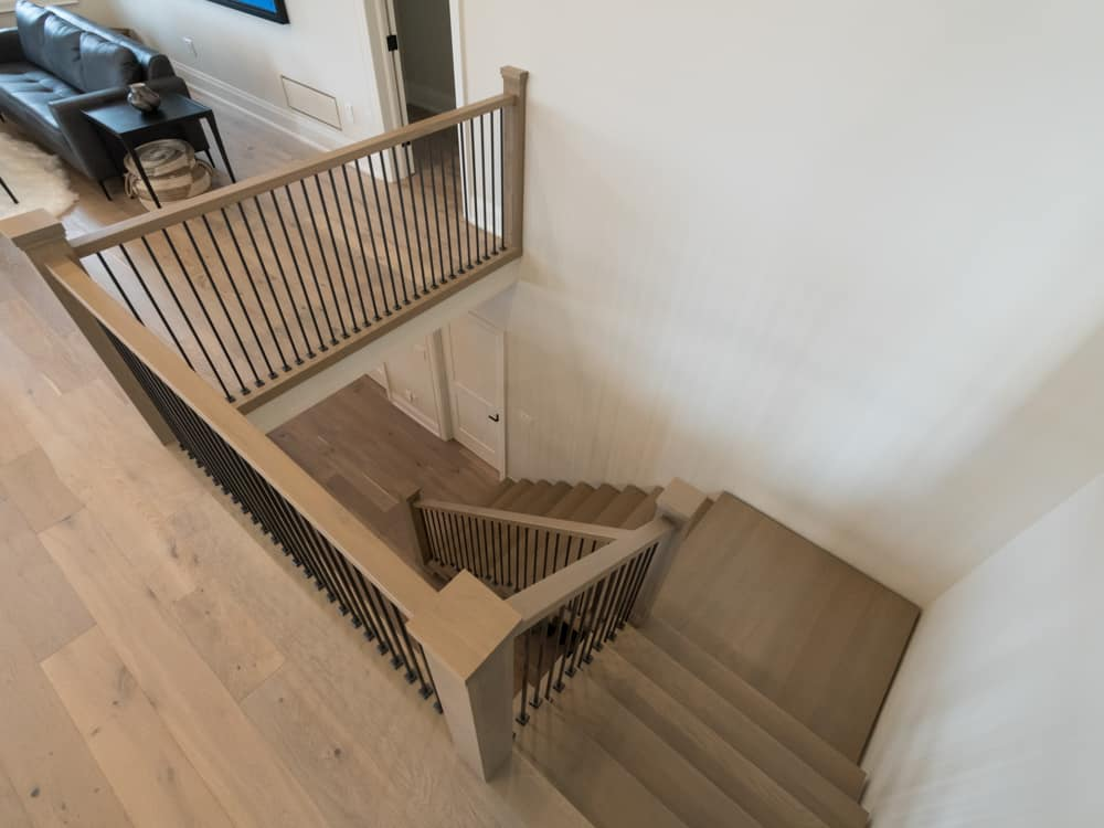 light grey wooden staircase.