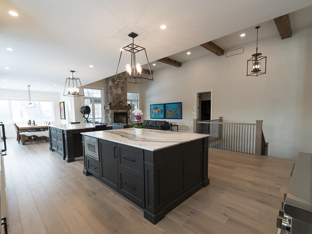 Dark cupboard island with marble countertops.