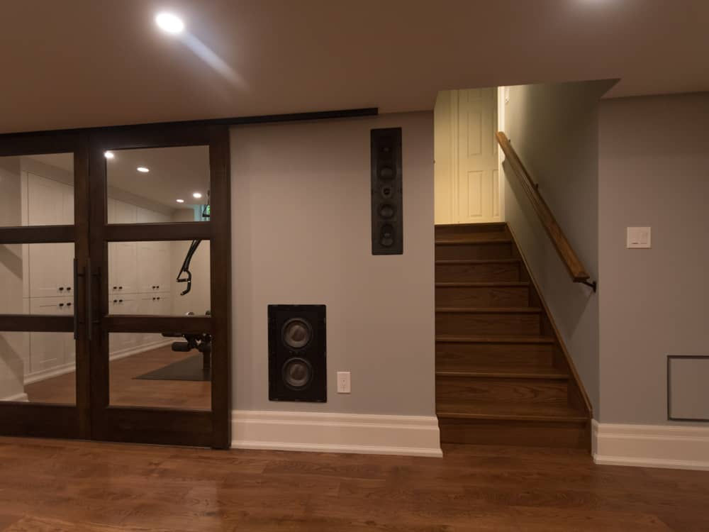 Barnboard sliding doors with windows, next to a staircase.