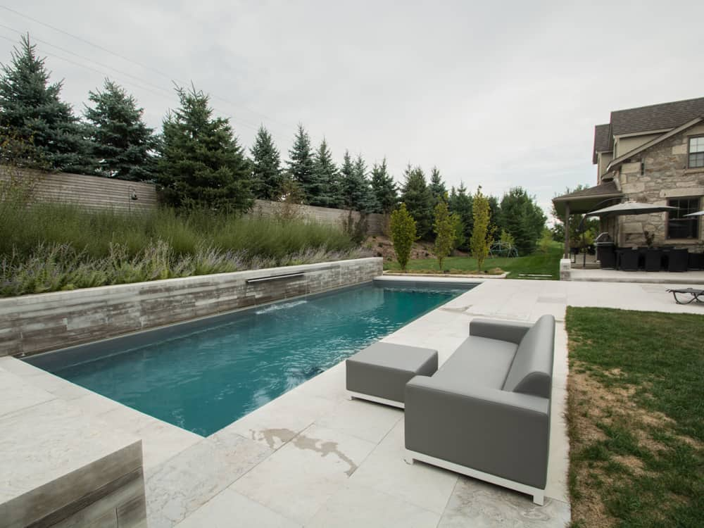 Pool surrounded by stone landing
