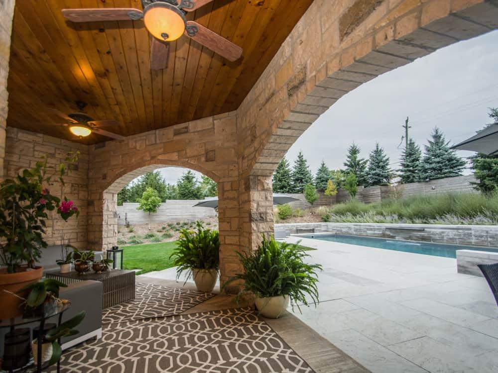 Wooden outdoor roof overlooking a pool.