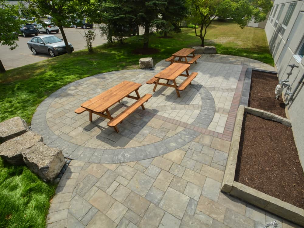 Outdoor community circle with picnic tables.