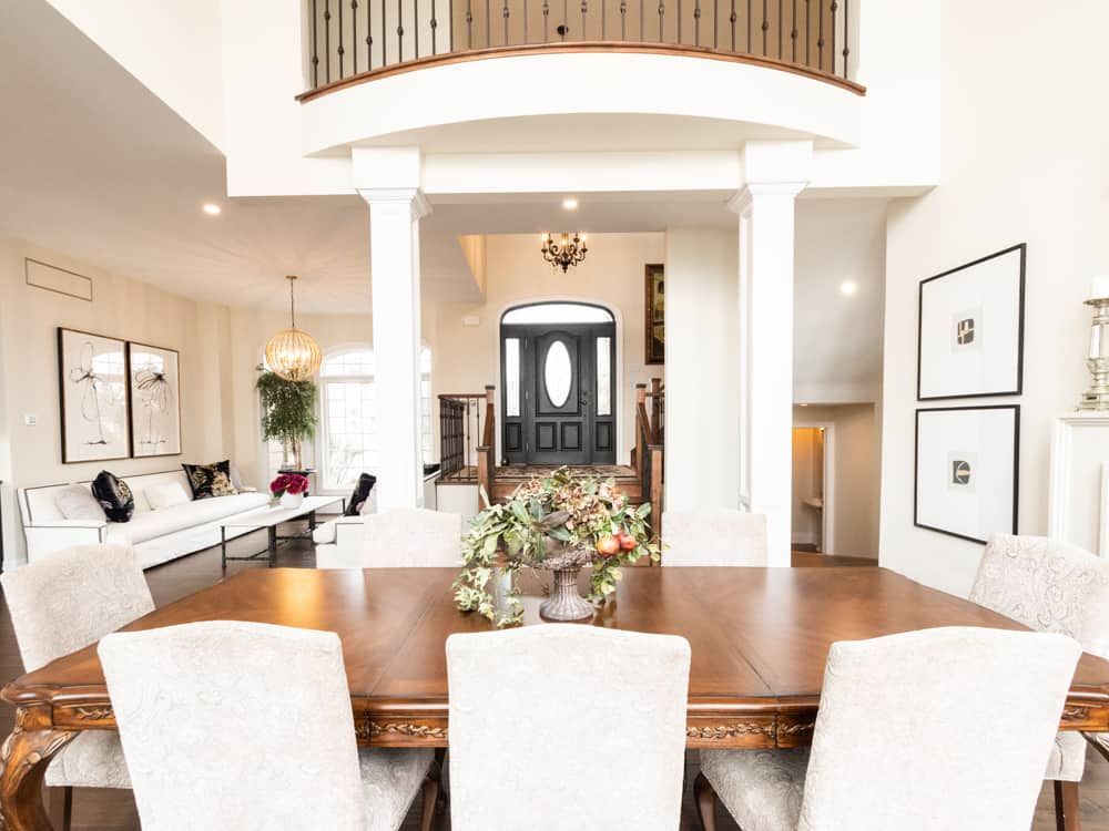 High ceilinged dining room, with the upper living space overlooking.