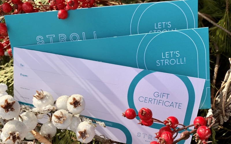 Stroll Gift Certificates tucked in a Christmas wreath