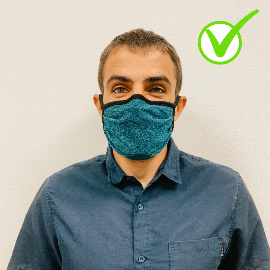 Legal assistant, Patrick, demonstrates how to wear a face mask correctly.