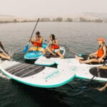 This is us, the team from Laureen Lane Law messing about on paddle boards.