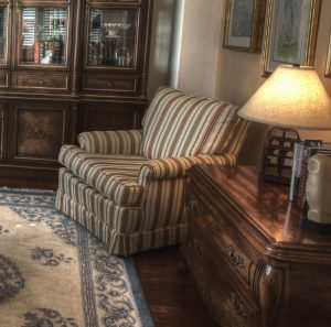 Reupholster a Chair to modernize a traditional home design