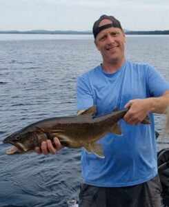 Maine fishing guide, Charles McGee, sporting a big lake catch in southern Maine.