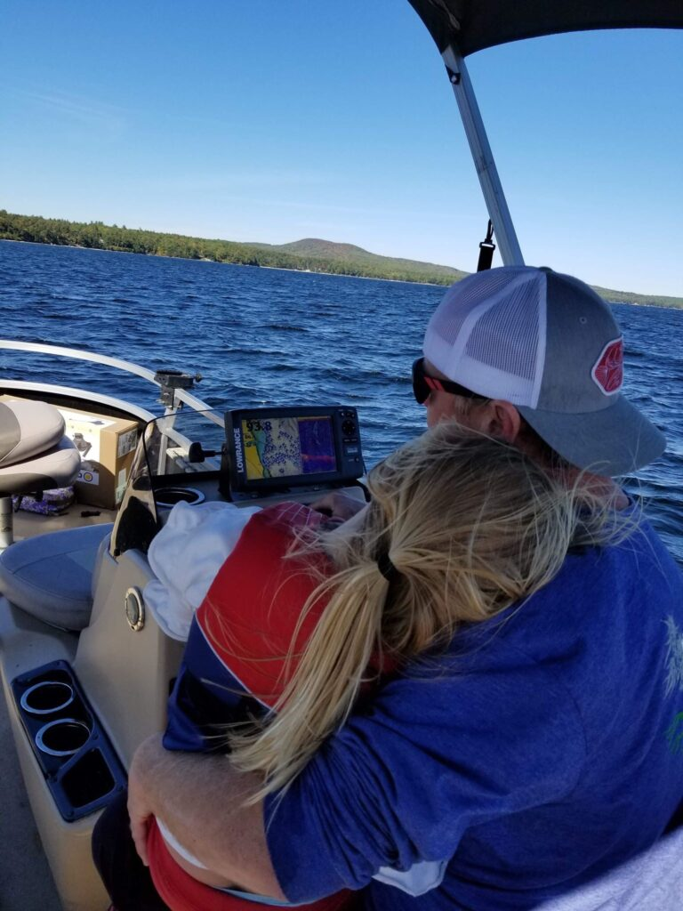 Photo of master fisherman Charlie McGee and his daughter, enjoying a cruise on a lake in southern Maine.