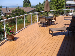 A photo of a deck with seating and lounge chairs.