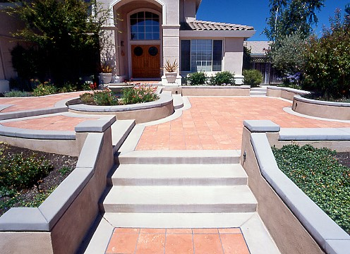 A photo of a multilevel brick and concrete patio area.