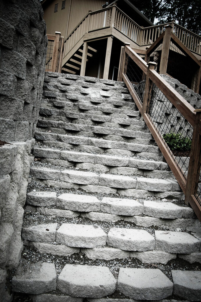 A photo of a stone stairway leading up to a house.