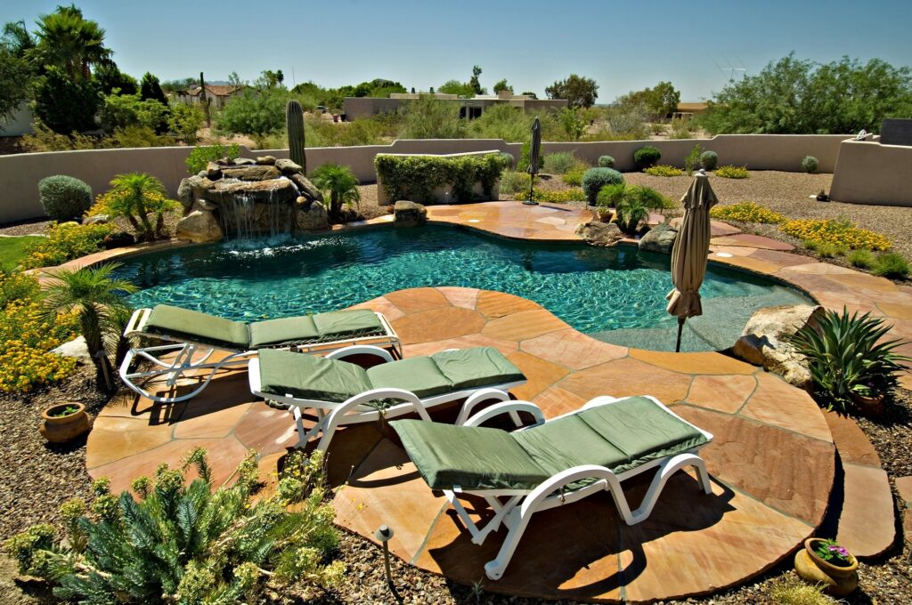 A photo of a landscaped pool area.