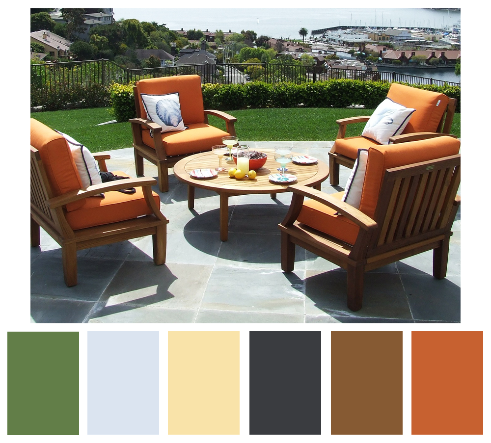 A mid-century modern inspired patio featuring wooden chairs with orange cushions.