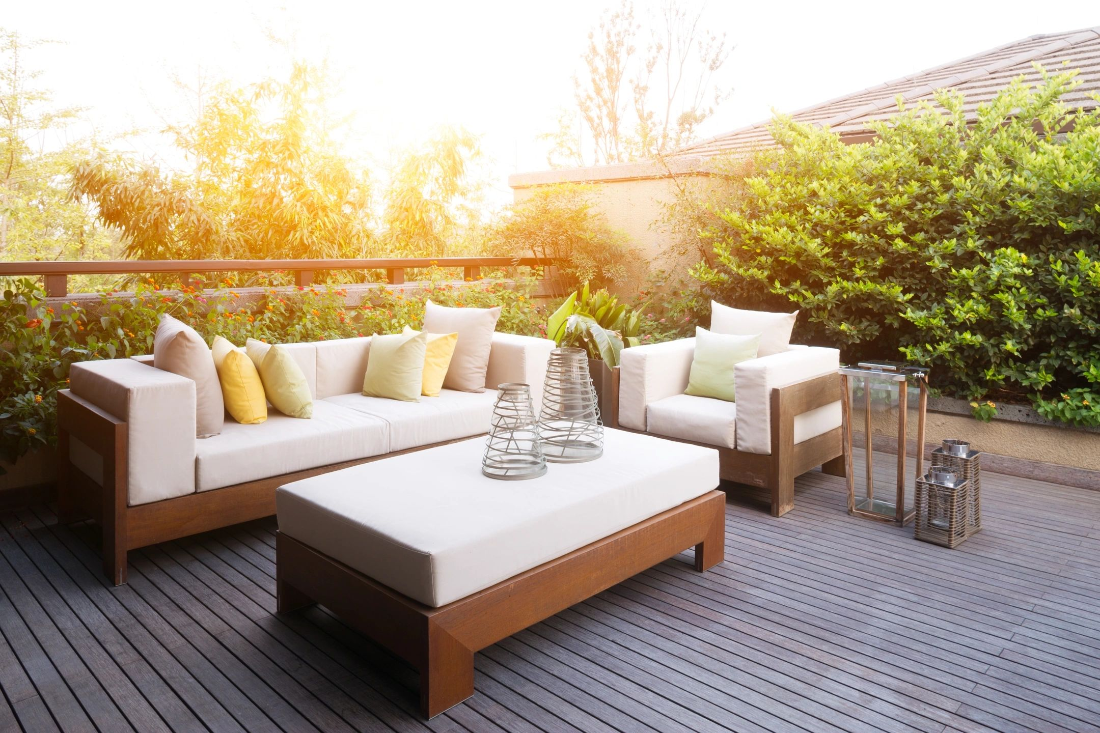 A photo of a outdoor furniture on a deck.