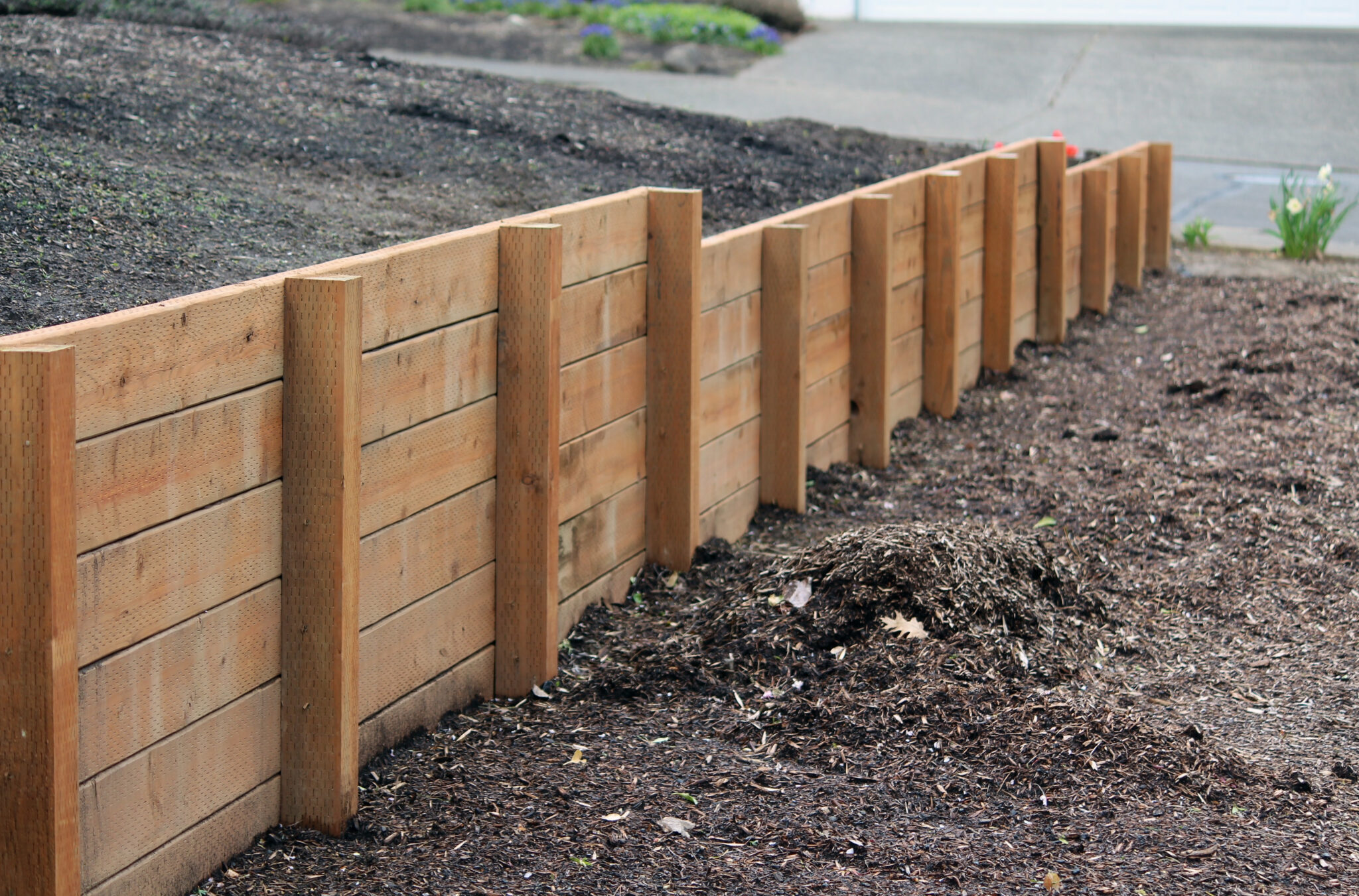 A retaining wall in a dirt yard.