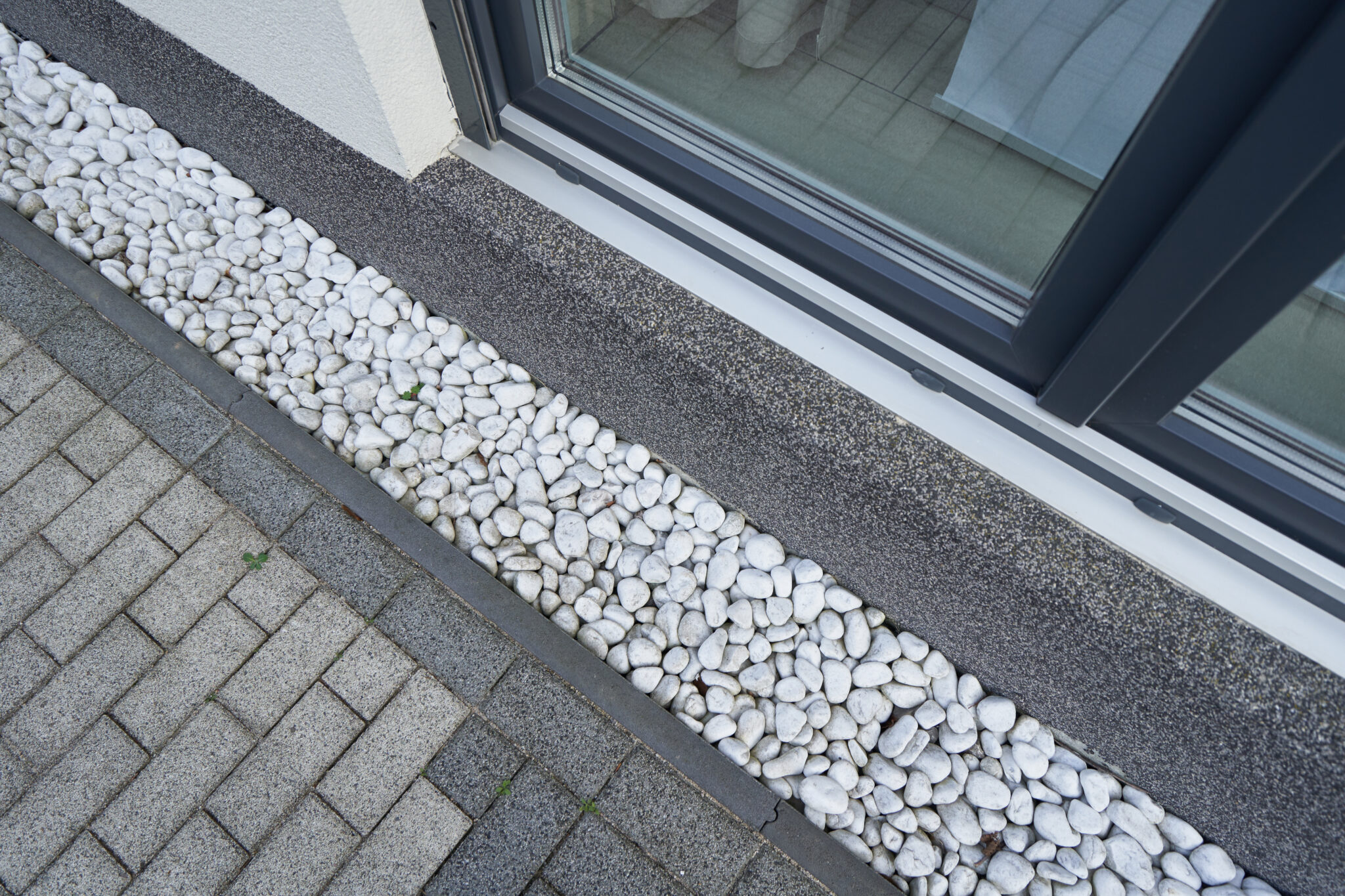 A drainage system lined with pebbles.