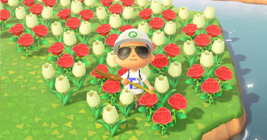 A photo of an Animal Crossing: New Horizons villager surrounded by white and red folowers.
