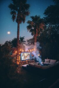 A photo of a backyard set up with a movie screening area.