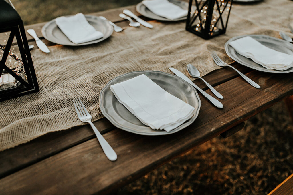 dinner plates on wood table outside