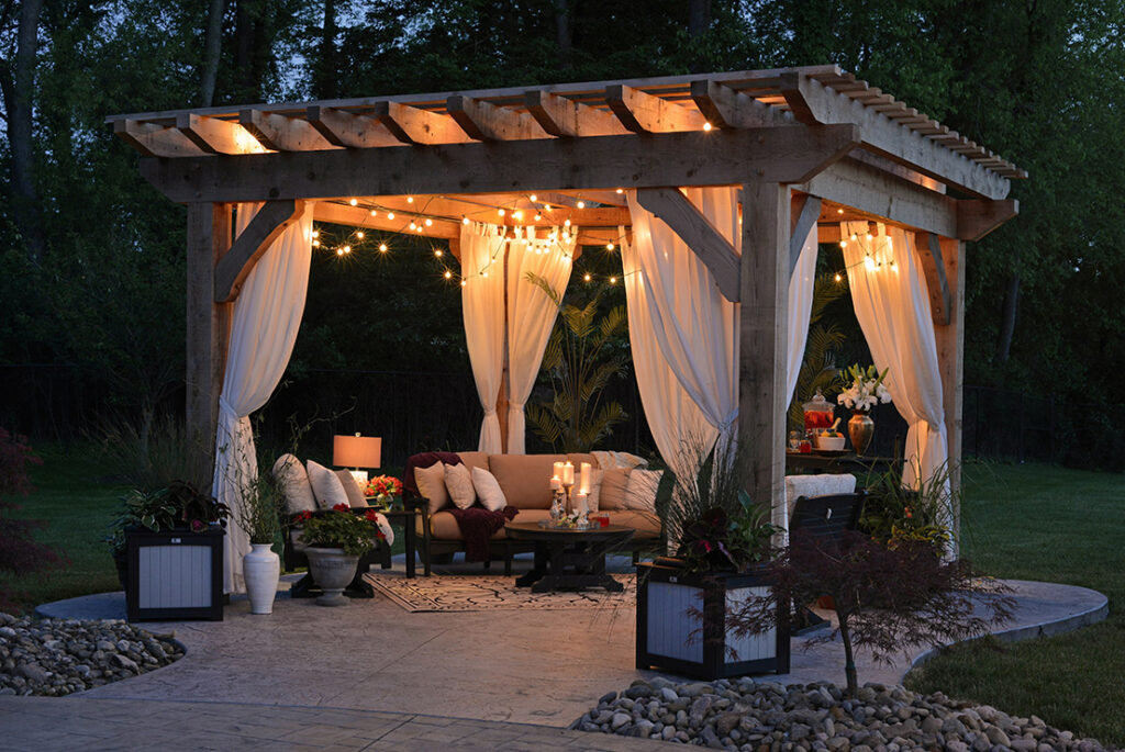 pergola in the night with lights and curtains