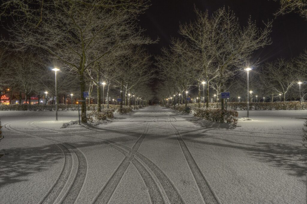 snow dusted parking lot and road