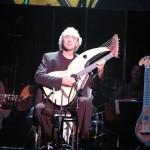 John Doan pefforms on harp guitar in concert.