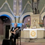 John Doan in Concert playing harp guitar in ancient church